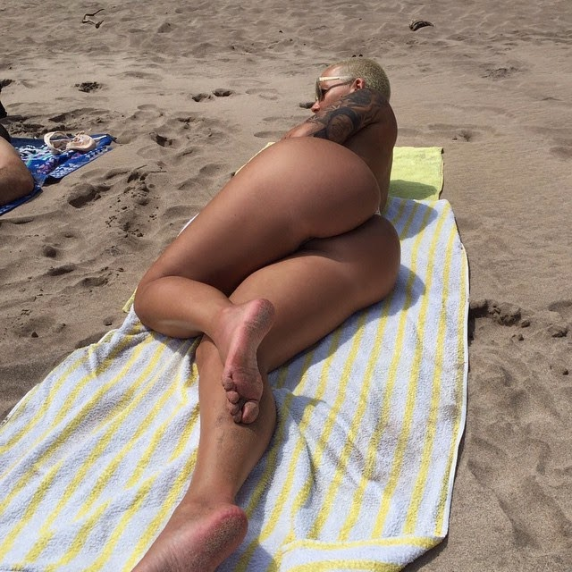 Amber Rose hits back at 'photoshop' claims of her beach pics, upload original pics