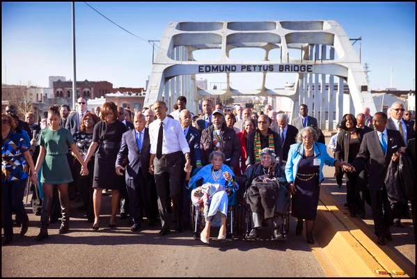 Barack Obama walks across the Edmund Pettus Bridge