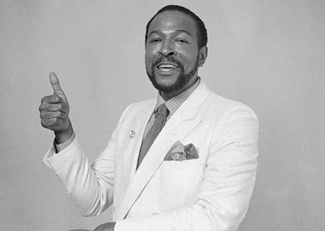 Marvin Gaye poses giving the thumbs up