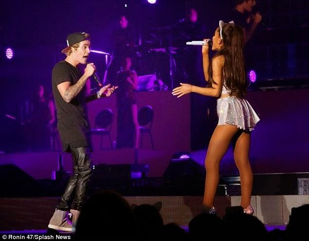 Justin Bieber grabs Ariana Grande from behind on stage,as Big Sean tweets his displeasure