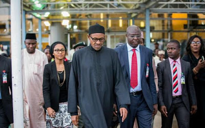 President- Elect Gen Buhari from the UK, with his daughter and Son