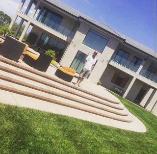 Chris Brown, buys new home, gets new tattoo