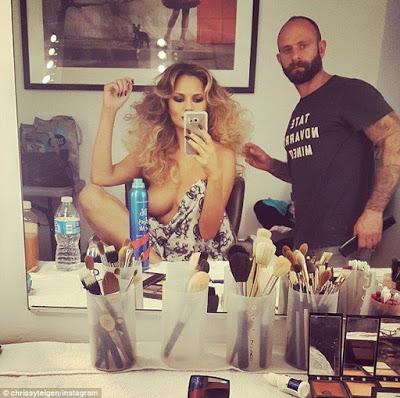 Chrissy Teigen  posts another topless shot on Instagram