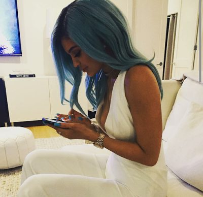 Kylie Jenner launches hair extensions, puts cleavage on display