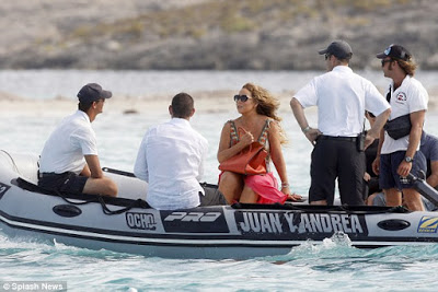 Mariah Carey nearly tumbled  down the stairs while climbing off her bf's yacht