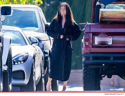 girl in scott Disick bathrobe