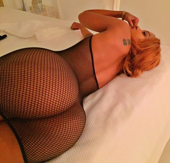 Huddah Monroe bares it all, wears only black net dress showing of all her cleavages