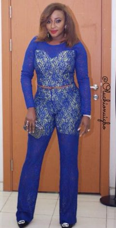 Ini Edo's rock a blue laced jump suit outfit to Dark movie premiere