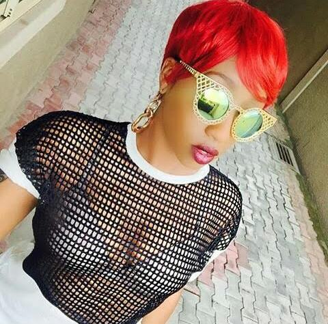 Kenyan Victoria Kimani rocks Red Hair Wig in Sexy Fishnet and Leggings Outfit