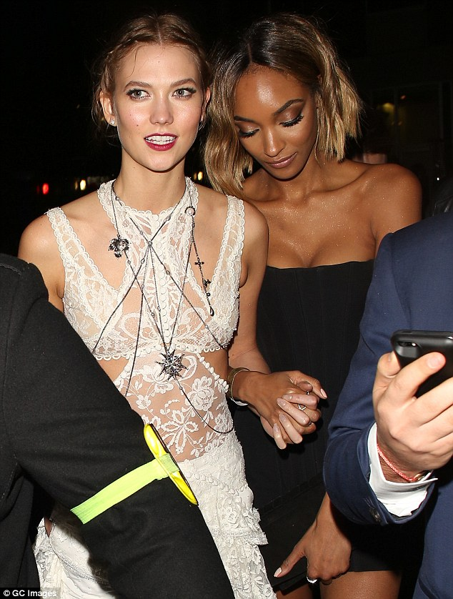 Jourdan puts on a busty display in black corset dress as she heads to BRITs after-party