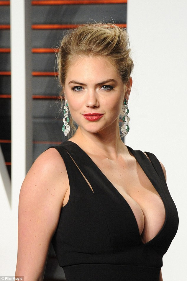 Kate Upton Lightsup the Vanity Fair Oscar afterparty as she ravishes in an Extremly Cleavage Baring Plunging Gown