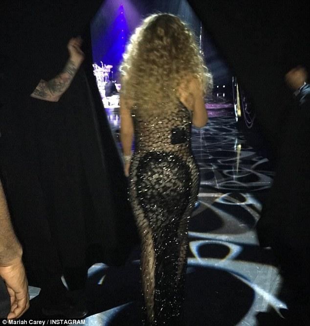 Mariah carey shares BTS photos as she glows in a Black Sheer Dress