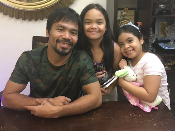 World Boxing Champion Manny Pacquiao Shares Photo of him Reading The Bible