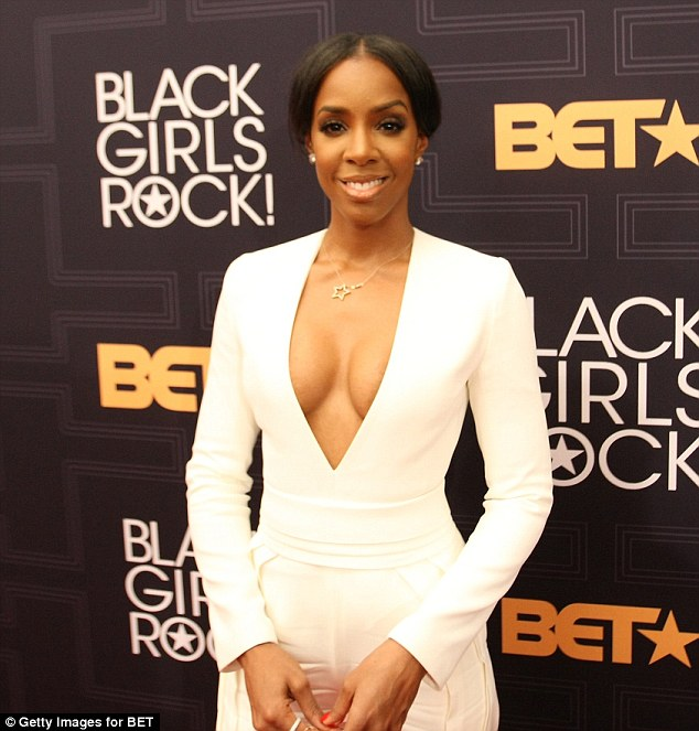 Kelly Rowland shows off her cleavages in  Very-Low Cut white Jumpsuit