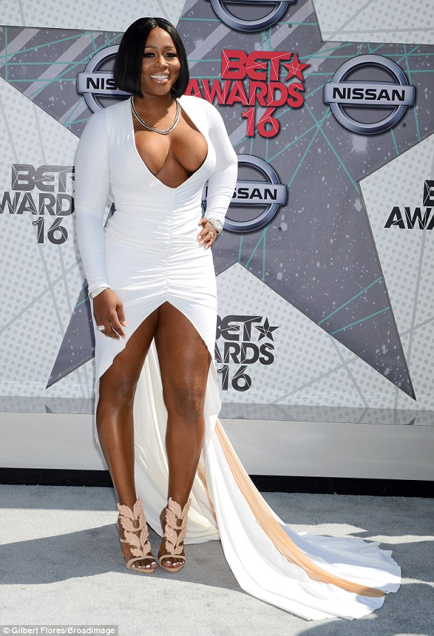 Rapper Remy Ma gets Extremely Raunchy displaying her Juicy Boobs in Plunging White Gown