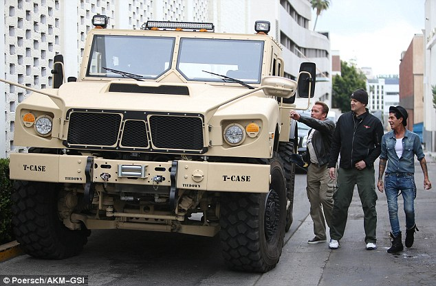 Former Califonia Governor Arnold Schwarzenegger spotted climbing into his giant military jeep