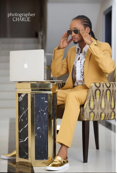 OMG!!! Denrele ditches his signature look for a suit in birthday photos