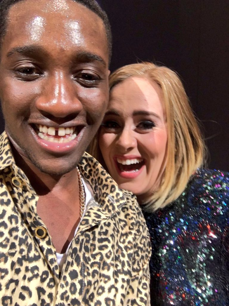 Adele Accidentally Kisses a Nigerian Fan On The Lips Onstage & The Crowd Freaks Out