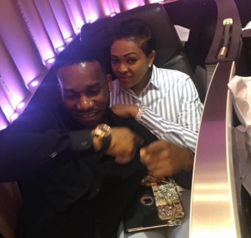 Jay Jay Okocha and Wife Nkechi Cuddle Up on Board while on a flight to Washigton DC