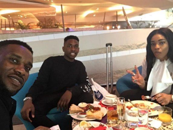 Jay Jay Okocha enjoys Lunch time with his Two Chidren A-jay and Daniella Okocha at Heathrow Airport