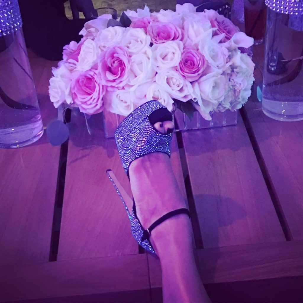 Jlo shows off her Shoe as she thanks her fans for all the Birthday Wishes,Cards and Massages