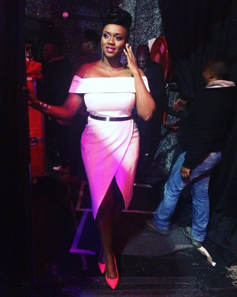Singer Waje shows off her hot pink dress on The Voice as she Premiers her Song Mountain