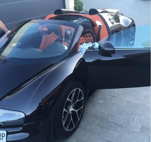 Cristiano Ronaldo shares Photo of his son in his New  $1.5 million Bugatti Veyron Sport Car