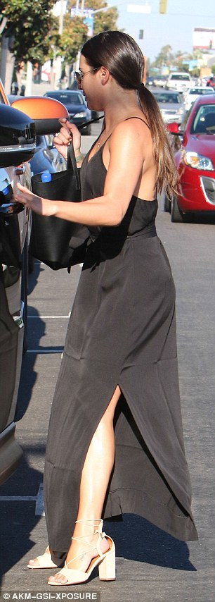 Lea Michele step out Braless in a black thigh-split maxi dress