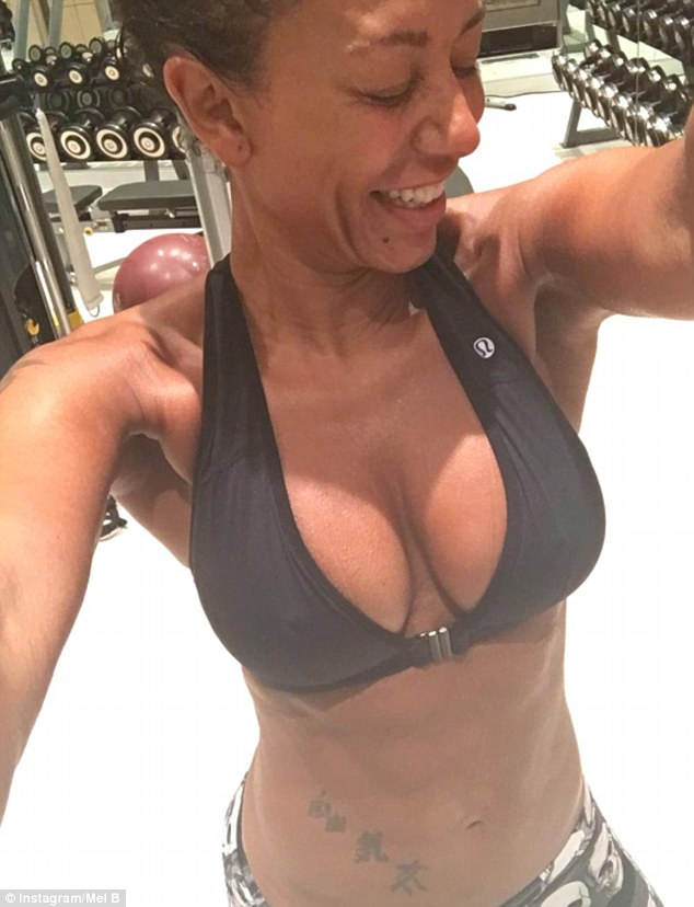 Mel B shows off her Busty Ample in a Closeup Photo wearing a Black Sport Bra