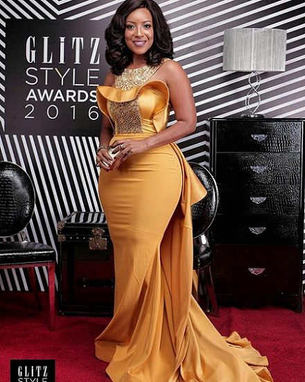 Actress Joselyn Dumas displays Her Hour Glass Figure in a sexy golden Yellow Dress