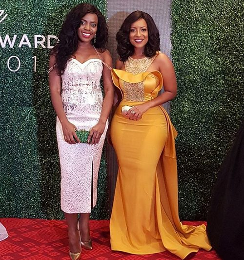 Joselyn Dumas displays Her Hour Glass Figure in a sexy golden Yellow Dress