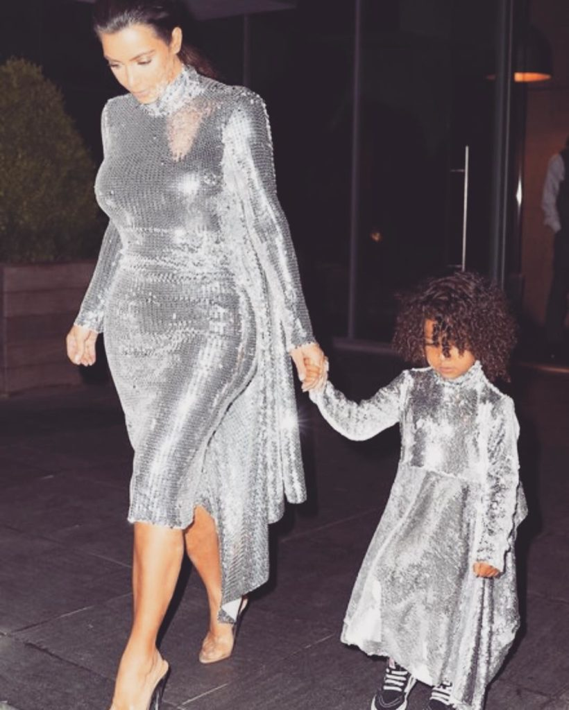 Kim and Her first daughter North West  looking Sexy in Metallic Grey Dress to Yeezy Season 4 Concert