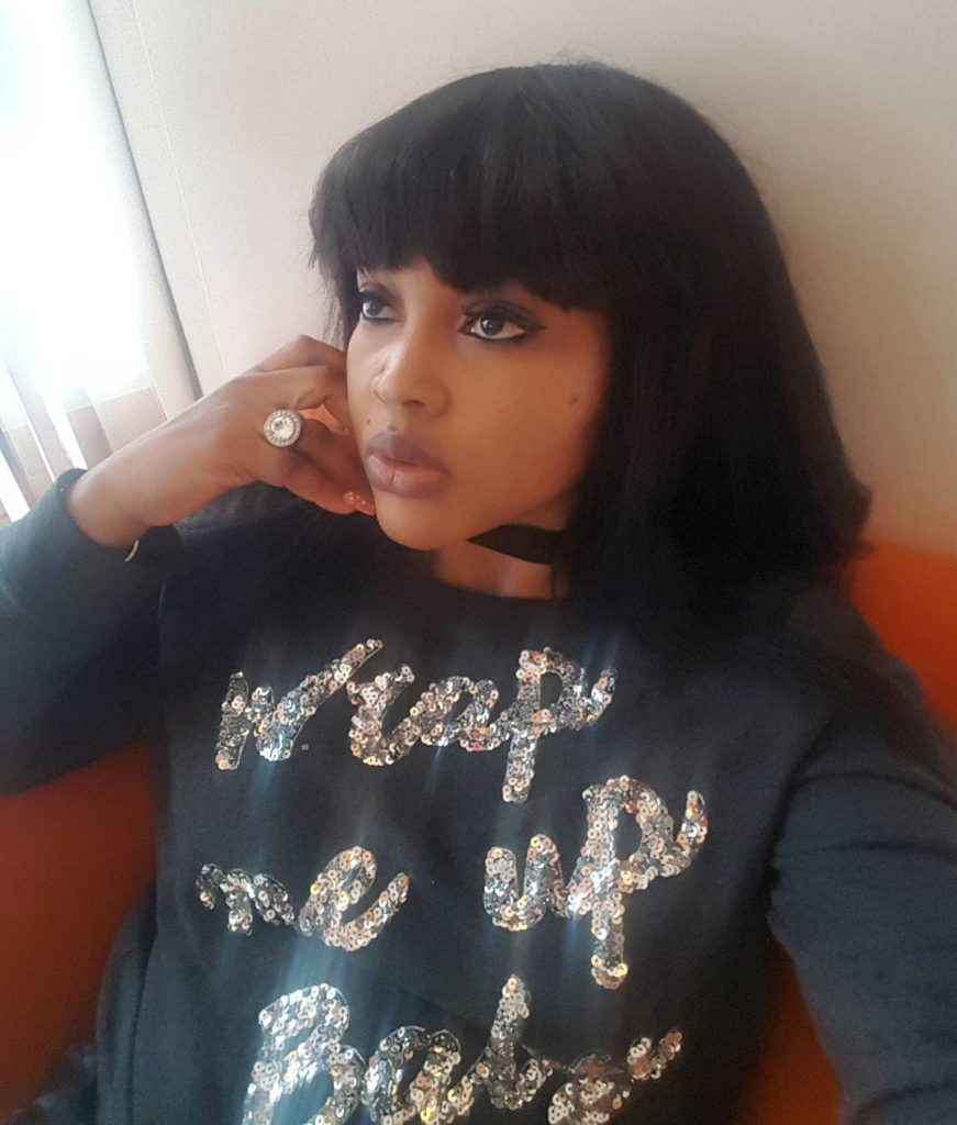 Mercy Aigbe Flawless in a Black Wrap me Up babe Sweater T-shirt