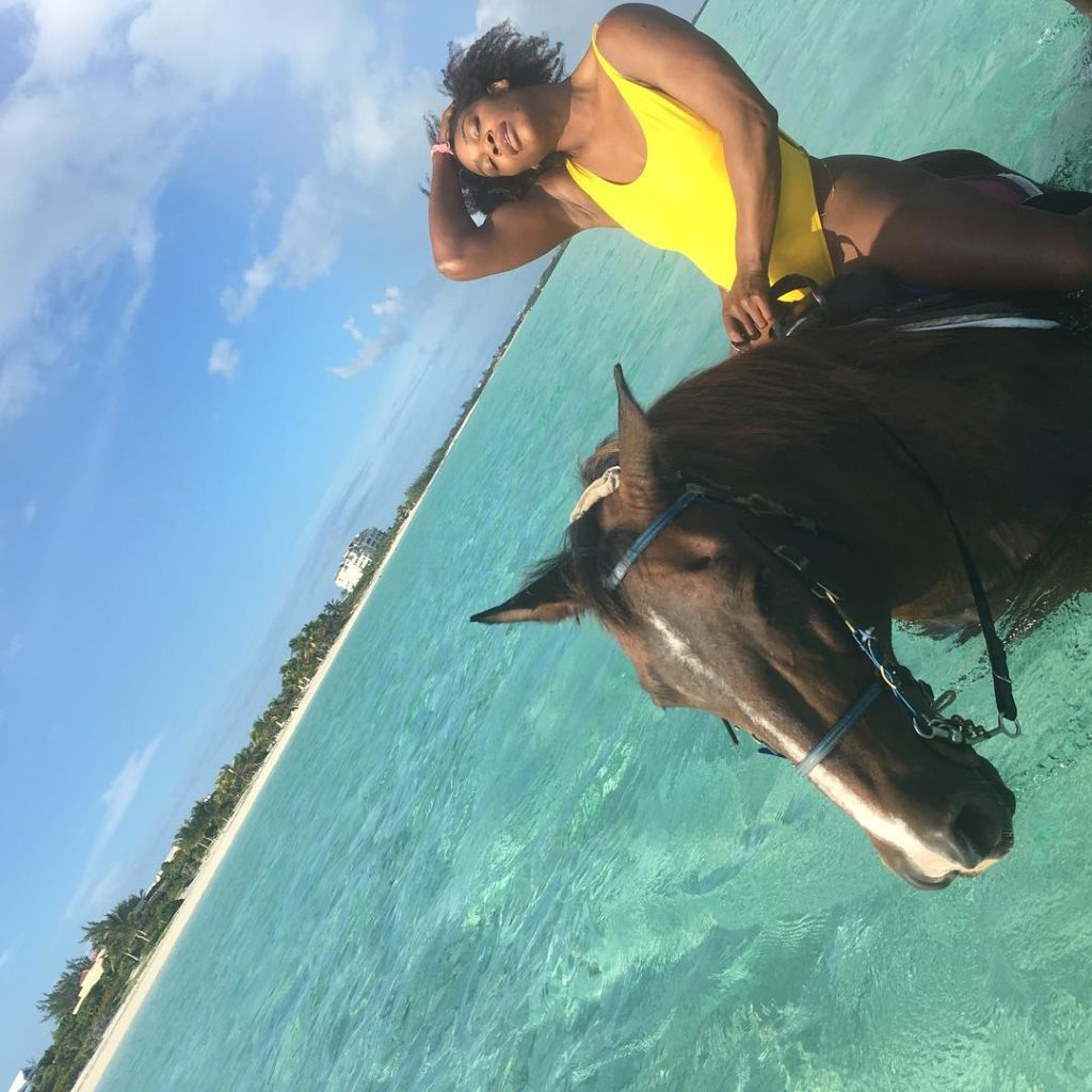 Serena Williams Sizzles in yellow Bikini as she Rides a Horse in the Ocean