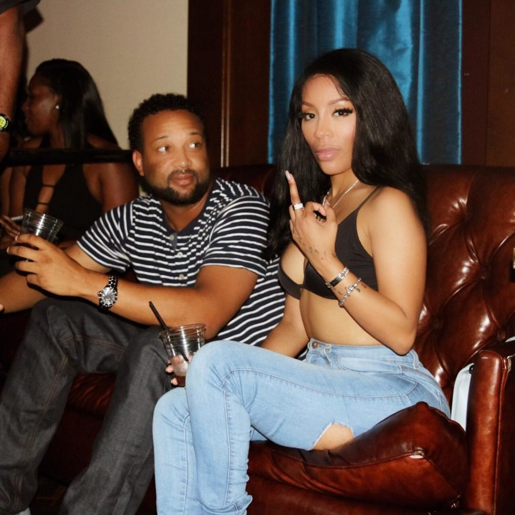 K Michelle puts her cleavages on display in a black Bra and Distressed Jeans