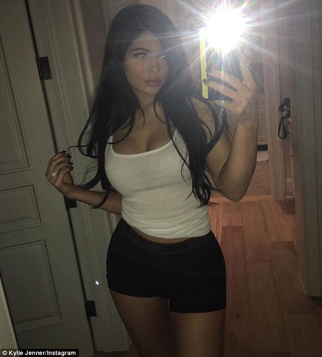 Kylie Jenner wears nothing but blue body paint in raunchy new photo shoot
