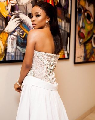 Toke Makinwa sexy gorgeous in her White Laced High Slit dress to her book launch
