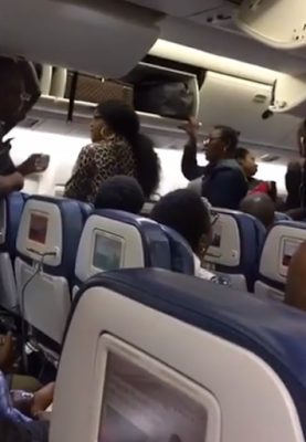 Dont Touch My LV Bag- Video of Two Nigerian women Arguing On Board a Delta Airline to Nigeria