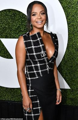 Kelly Rowland  and  Christina Milan put boobs on display at GQ Men Of The Year party