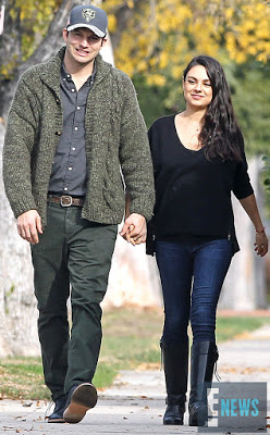 Mila Kunis and husband Ashton Kutcher step out for the first time since they welcomed  a baby boy
