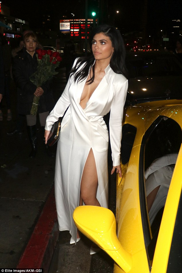 Kylie Jenner enjoys a date night With Tyga in a Braless White Silk Dress