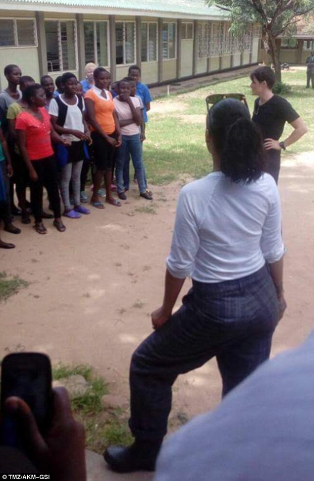 Rihanna stylish in a white Top and Checked Trousers as she visits School in Malawi
