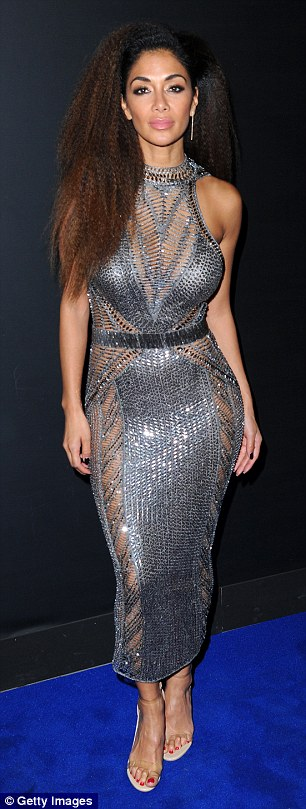 Nicole Scherzinger Goes nude in sheer dress As She Poses For Photos At The Brit Awards