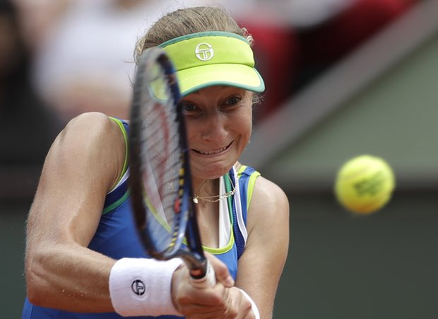 Russia's Ekaterina Makarova returns the ball to Germany's Angelique Kerber