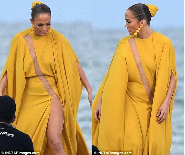 Jennifer Lopez raunchy as she goes Braless in a Yellow Cutout Dress Without Underwear