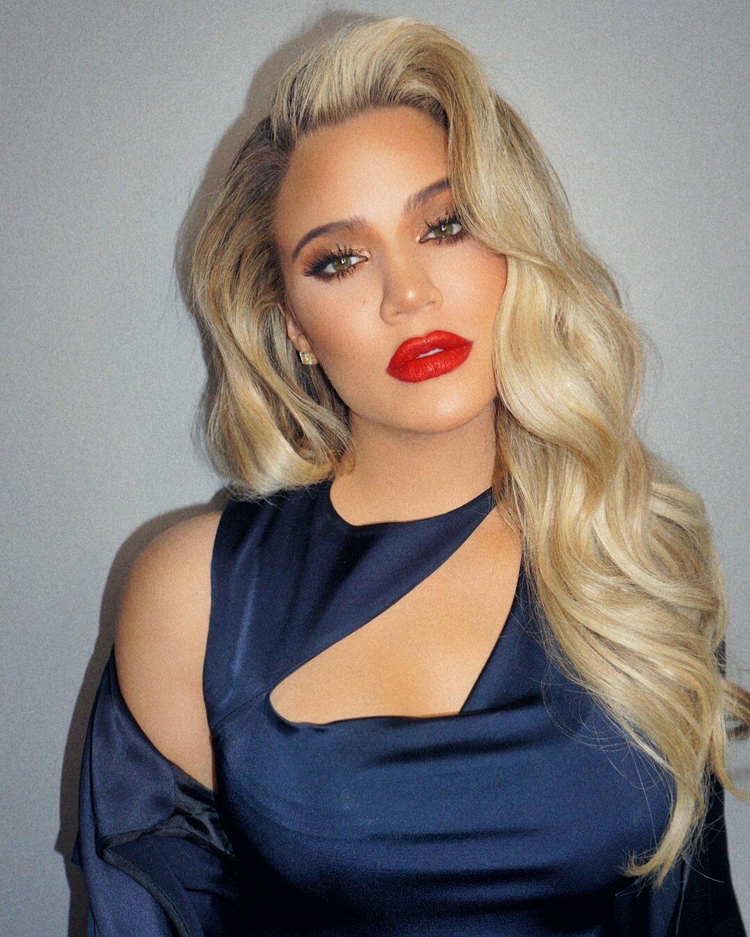 Pregnant Khloe Kardashian wows in green