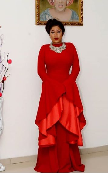 Toyin Aimakhu Slays in a red floor length dress for Disguise movie Premiere