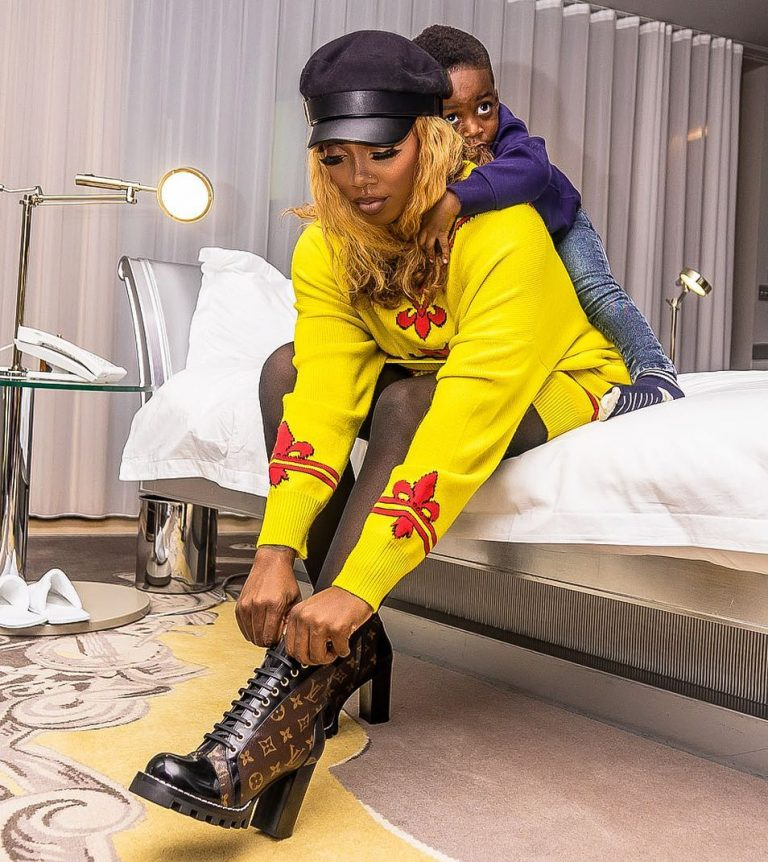 Tiwa Savage slays in shades of yellow with Gucci Boot