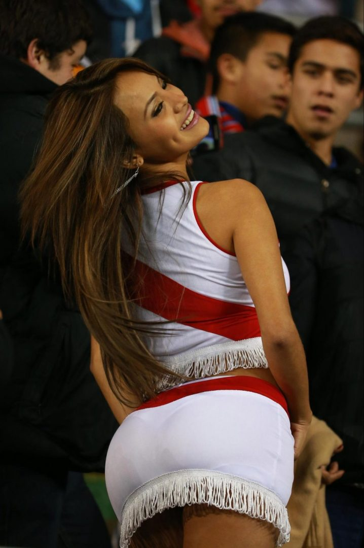 Meet Nissu Cauti, The Pretty Lady Who Takes Off Her Top Whenever Her Team Scores (Photos)