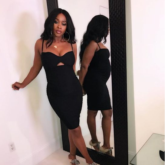 Remy Ma slays in black dress as she flaunts her growing baby bump